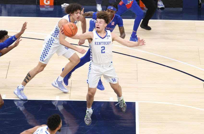 INDIANAPOLIS, INDIANA - DECEMBER 01: Devin Askew #2 of the Kentucky Wildcats grabs a rebound against the Kansas Jayhawks in the State Farm Champions Classic at Bankers Life Fieldhouse on December 01, 2020 in Indianapolis, Indiana. (Photo by Andy Lyons/Getty Images)