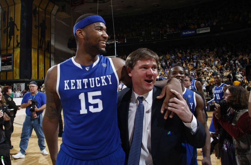 NASHVILLE, TN - FEBRUARY 20: DeMarcus Cousins #15 of the Kentucky Wildcats celebrates with assistant coach John Robic after the game against the Vanderbilt Commodores at Memorial Gymnasium on February 20, 2010 in Nashville, Tennessee. Kentucky defeated Vanderbilt 58-56. (Photo by Joe Robbins/Getty Images)