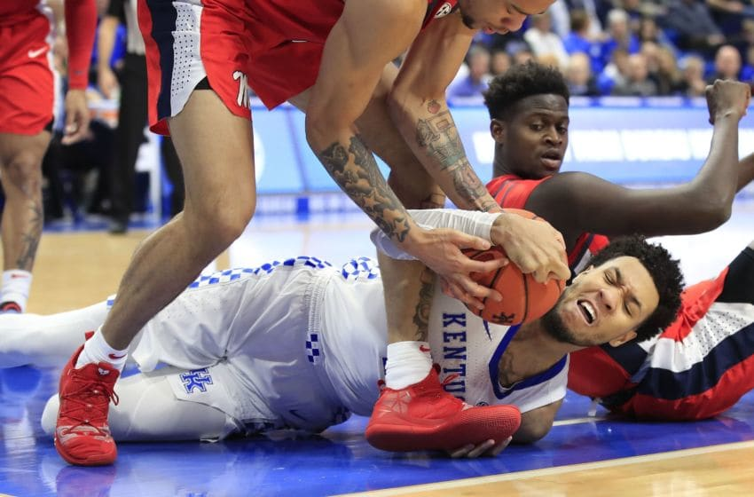 LEXINGTON, KENTUCKY - FEBRUARY 15: EJ Montgomery #23 of the Kentucky Wildcats battles for a loose ball with KJ Buffen #5 of the Ole Miss Rebels at Rupp Arena on February 15, 2020 in Lexington, Kentucky. (Photo by Andy Lyons/Getty Images)