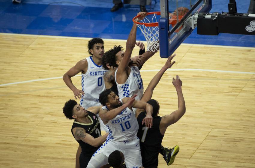 Kentucky Wildcats guard Davion Mintz (10), forward Oliver Sarr Credit: Arden Barnes-USA TODAY Sports