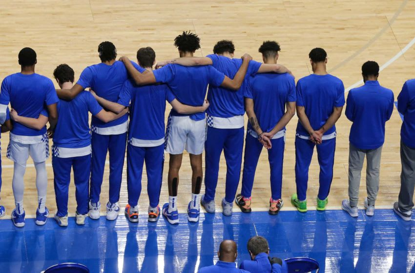 The Kentucky men's basketball team embraced during a moment of silence as they honored former walk-on Ben Jordan