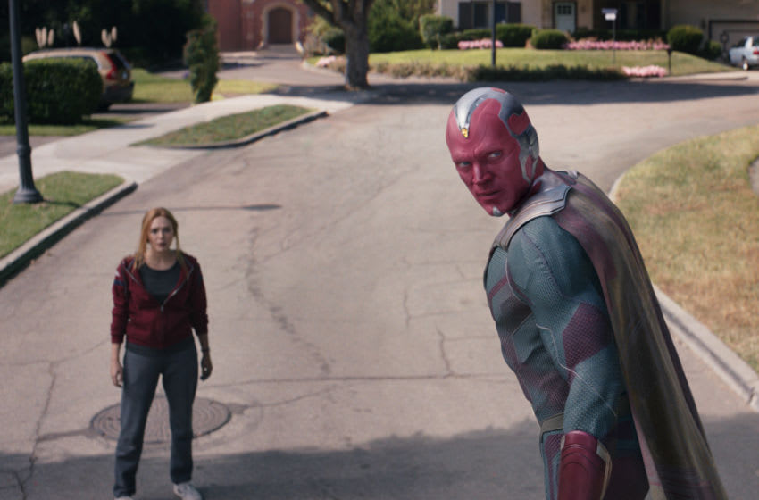 Elizabeth Olsen as Wanda Maximoff and Paul Bettany as Vision in Marvel Studios' WandaVision. Photo courtesy of Marvel Studios. ©Marvel Studios 2021 All Rights Reserved.