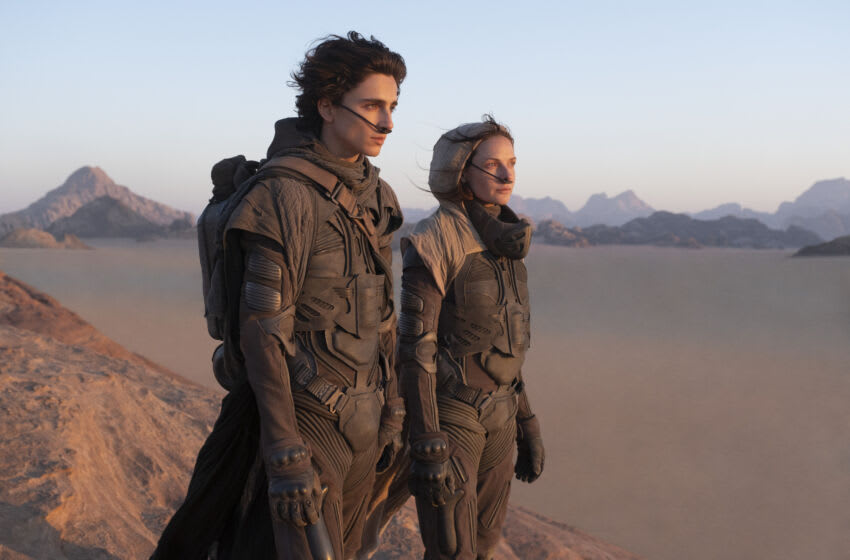 """(L-r) TIMOTHÉE CHALAMET as Paul Atreides and REBECCA FERGUSON as Lady Jessica Atreides in Warner Bros. Pictures and Legendary Pictures' action adventure """"DUNE,"""" a Warner Bros. Pictures release. Courtesy of Warner Bros. Pictures and Legendary Pictures, Chiabella James"""