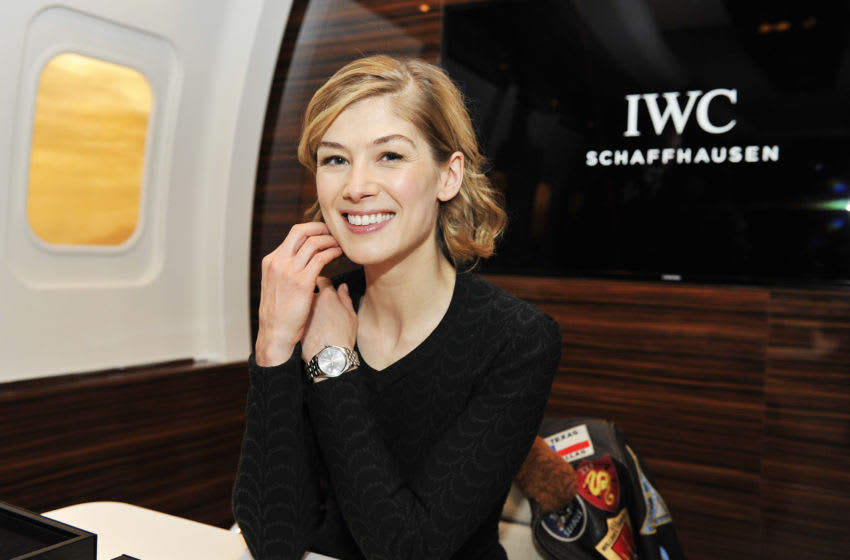 GENEVA, SWITZERLAND - JANUARY 19: Rosamund Pike visits the IWC booth during the launch of the Pilot's Watches Novelties from the Swiss luxury watch manufacturer IWC Schaffhausen at the Salon International de la Haute Horlogerie (SIHH) 2016 on January 19, 2016 in Geneva, Switzerland. (Photo by Harold Cunningham/Getty Images for IWC)