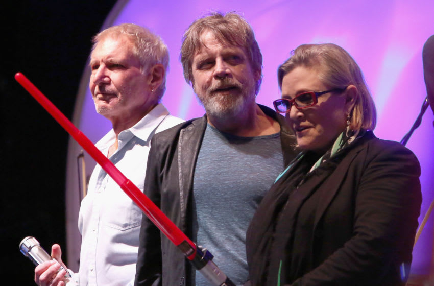 SAN DIEGO, CA - JULY 10: (L-R) Actors Harrison Ford, Mark Hamill, Carrie Fisher and more than 6000 fans enjoyed a surprise