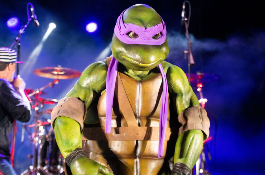 VENTURA, CALIFORNIA - JULY 24: The Teenage Mutant Ninja Turtles perform onstage with Vanilla Ice during the 9th Annual Tequila & Taco Music Festival at Ventura County Fairgrounds and Event Center on July 24, 2021 in Ventura, California. (Photo by Scott Dudelson/Getty Images)