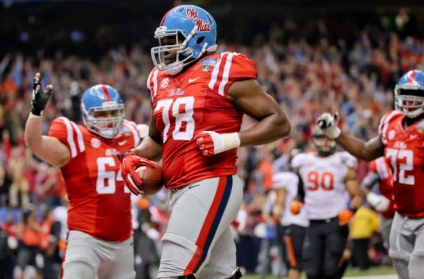 Jan 1, 2016; New Orleans, LA, USA; Mississippi Rebels offensive lineman Laremy Tunsil (78) scores on a touchdown pass against the Oklahoma State Cowboys during the second quarter in the 2016 Sugar Bowl at the Mercedes-Benz Superdome. Mandatory Credit: Derick E. Hingle-USA TODAY Sports