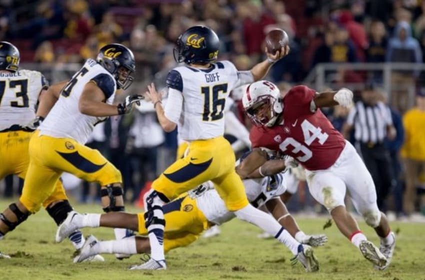 Nov 21, 2015; Stanford, CA, USA; California Golden Bears quarterback Jared Goff (16) throws the ball under pressure from Stanford Cardinal linebacker Peter Kalambayi (34) during the fourth quarter at Stanford Stadium. Stanford defeated California 35-22. Mandatory Credit: Kelley L Cox-USA TODAY Sports