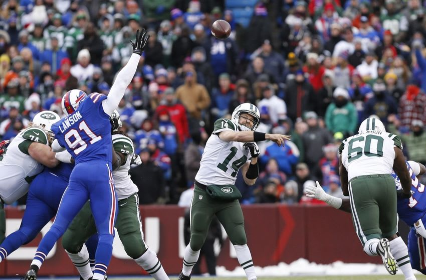 Jan 3, 2016; Orchard Park, NY, USA; New York Jets quarterback Ryan Fitzpatrick (14) throws a pass under pressure by Buffalo Bills outside linebacker Manny Lawson (91) during the second half at Ralph Wilson Stadium. Bills beat the Jets 22-17. Mandatory Credit: Kevin Hoffman-USA TODAY Sports