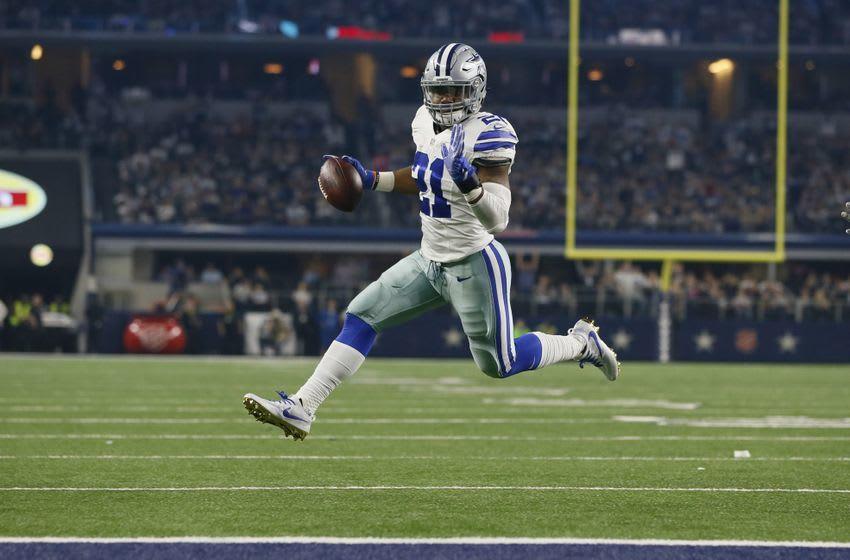 Dec 26, 2016; Arlington, TX, USA; Dallas Cowboys running back Ezekiel Elliott (21) runs for a touchdown in the third quarter against the Detroit Lions at AT&T Stadium. Mandatory Credit: Tim Heitman-USA TODAY Sports