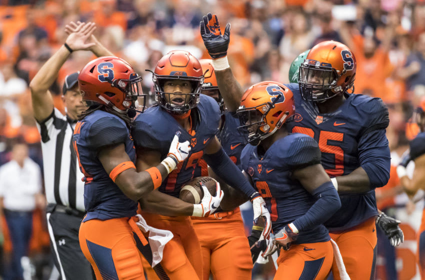 SYRACUSE, NY - SEPTEMBER 08: Andre Cisco #19 of the Syracuse Orange celebrates an interception during the first quarter against the Wagner Seahawks at the Carrier Dome on September 8, 2018 in Syracuse, New York. (Photo by Brett Carlsen/Getty Images)