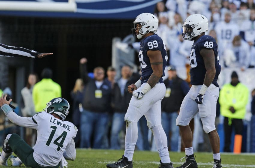 STATE COLLEGE, PA - OCTOBER 13: Yetur Gross-Matos #99 of the Penn State Nittany Lions celebrates against Brian Lewerke #14 of the Michigan State Spartans on October 13, 2018 at Beaver Stadium in State College, Pennsylvania. (Photo by Justin K. Aller/Getty Images)