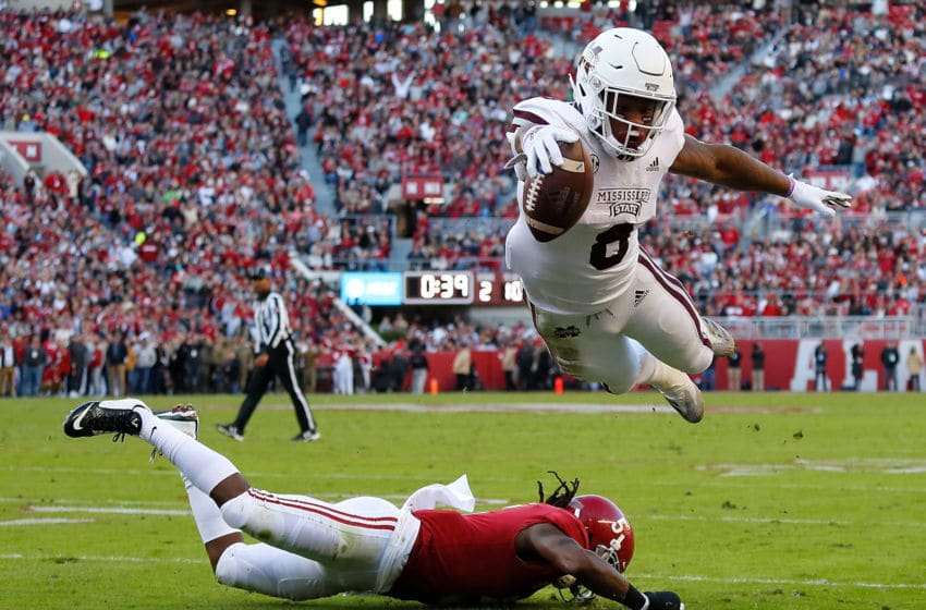 TUSCALOOSA, AL - NOVEMBER 10: Kylin Hill #8 of the Mississippi State Bulldogs dives for a touchdown over Shyheim Carter #5 of the Alabama Crimson Tide at Bryant-Denny Stadium on November 10, 2018 in Tuscaloosa, Alabama. The touchdown was called back on an offensive penalty. (Photo by Kevin C. Cox/Getty Images)