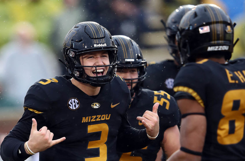 COLUMBIA, MISSOURI - NOVEMBER 23: Quarterback Drew Lock #3 of the Missouri Tigers celebrates with teammates 1after scoring a touchdown during the game against the Arkansas Razorbacks at Faurot Field/Memorial Stadium on November 23, 2018 in Columbia, Missouri. (Photo by Jamie Squire/Getty Images)