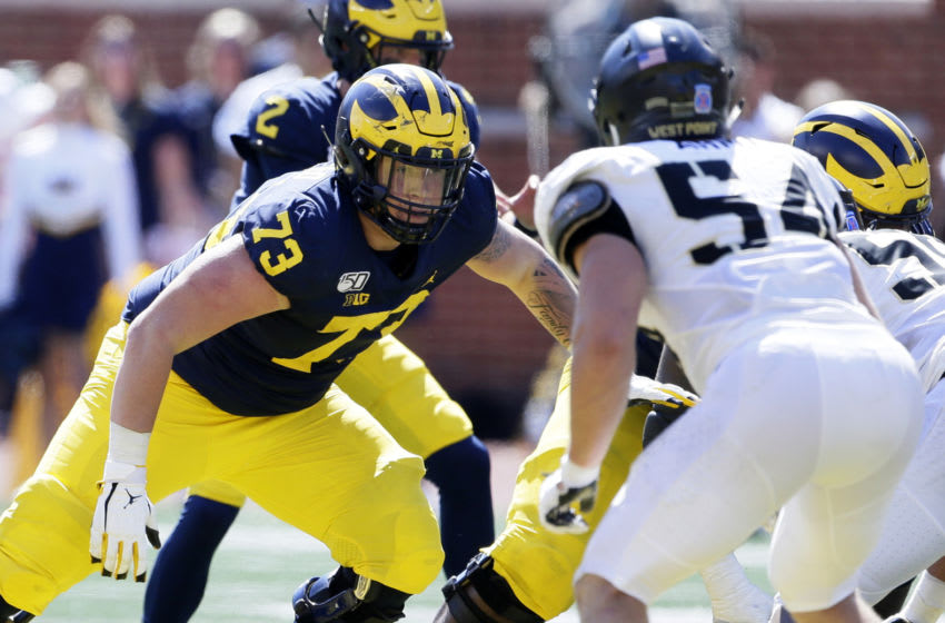 ANN ARBOR, MI - SEPTEMBER 07: Offensive lineman Jalen Mayfield #73 of the Michigan Wolverines off the line against linebacker Cole Christiansen #54 of the Army Black Knights during the second half at Michigan Stadium on September 7, 2019 in Ann Arbor, Michigan. (Photo by Duane Burleson/Getty Images)