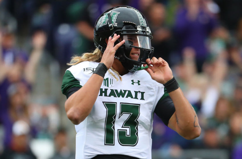 SEATTLE, WASHINGTON - SEPTEMBER 14: Cole McDonald #13 of the Hawaii Rainbow Warriors reacts after throwing an interception against the Washington Huskies in the first quarter during their game at Husky Stadium on September 14, 2019 in Seattle, Washington. (Photo by Abbie Parr/Getty Images)