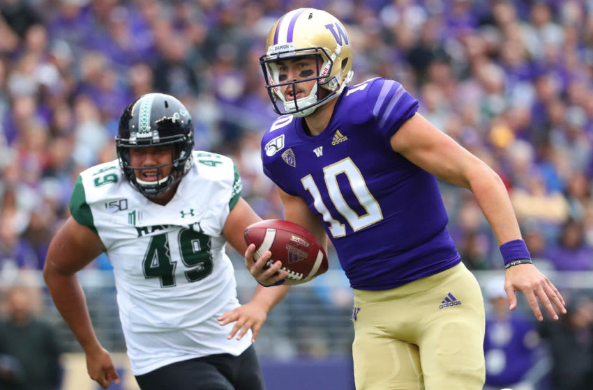 SEATTLE, WASHINGTON - SEPTEMBER 14: Jacob Eason #10 of the Washington Huskies runs with the ball against Manly Williams #49 of the Hawaii Rainbow Warriors in the first quarter during their game at Husky Stadium on September 14, 2019 in Seattle, Washington. (Photo by Abbie Parr/Getty Images)