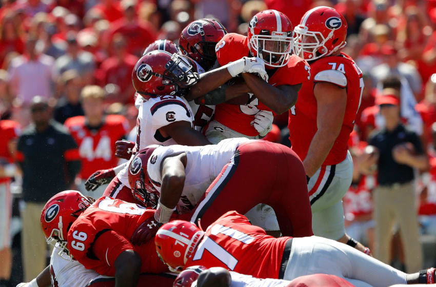 ATHENS, GEORGIA - OCTOBER 12: Zamir White #3 of the Georgia Bulldogs is tackled and pushed backward by J.T. Ibe #29 and Ernest Jones #53 of the South Carolina Gamecocks in the first half at Sanford Stadium on October 12, 2019 in Athens, Georgia. (Photo by Kevin C. Cox/Getty Images)