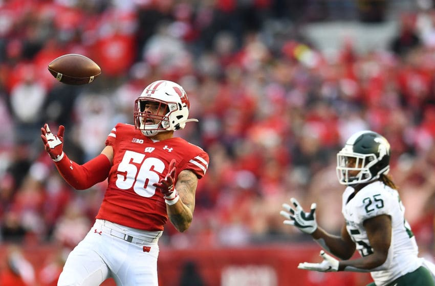MADISON, WISCONSIN - OCTOBER 12: Zack Baun #56 of the Wisconsin Badgers intercepts a pass intended for Darrell Stewart Jr. #25 of the Michigan State Spartans during the second half of a game at Camp Randall Stadium on October 12, 2019 in Madison, Wisconsin. (Photo by Stacy Revere/Getty Images)