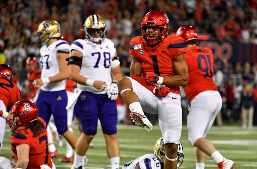 TUCSON, ARIZONA - OCTOBER 12: Tony Fields II #1 of the Arizona Wildcats celebrates after stopping Salvon Ahmed #26 of the Washington Huskies for a short gain during the end of the second quarter of the game at Arizona Stadium on October 12, 2019 in Tucson, Arizona. (Photo by Alika Jenner/Getty Images)