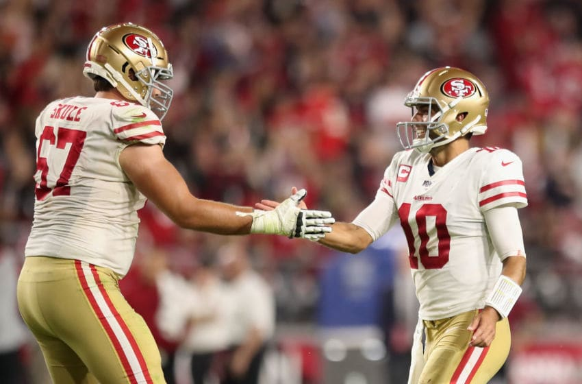 GLENDALE, ARIZONA - OCTOBER 31: Quarterback Jimmy Garoppolo #10 of the San Francisco 49ers celebrates with offensive tackle Justin Skule #67 after throwing a 21 yard touchdown reception to Dante Pettis (not pictured) during the second half of the NFL game against the Arizona Cardinals at State Farm Stadium on October 31, 2019 in Glendale, Arizona. The 49ers defeated the Cardinals 28-25. (Photo by Christian Petersen/Getty Images)