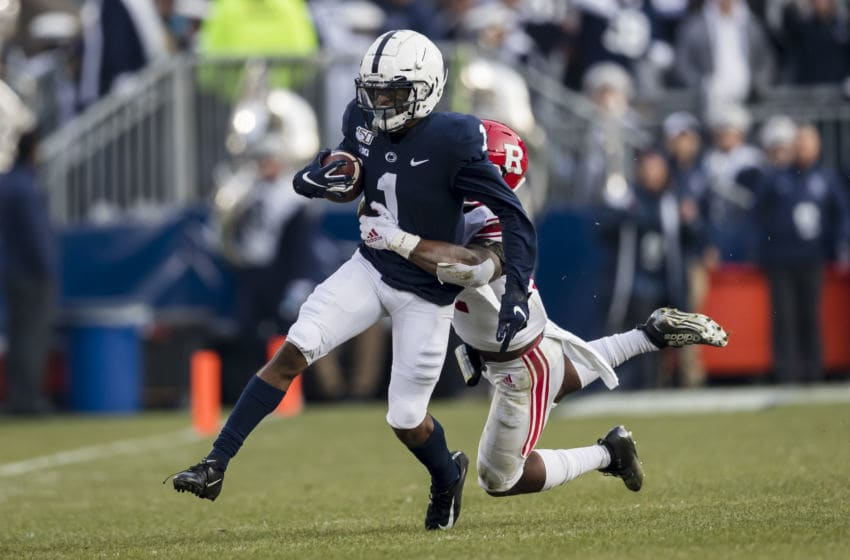 STATE COLLEGE, PA - NOVEMBER 30: KJ Hamler #1 of the Penn State Nittany Lions carries the ball as Christian Izien #12 of the Rutgers Scarlet Knights defends in the first half at Beaver Stadium on November 30, 2019 in State College, Pennsylvania. (Photo by Scott Taetsch/Getty Images)