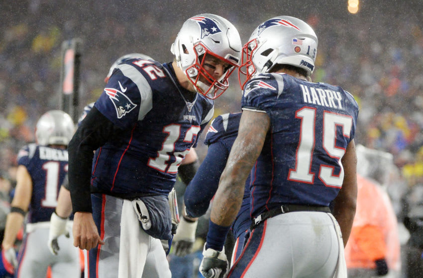 FOXBOROUGH, MASSACHUSETTS - NOVEMBER 24: Tom Brady #12 and N'Keal Harry #15 of the New England Patriots celebrate after scoring a touchdown during the first quarter against the Dallas Cowboys in the game at Gillette Stadium on November 24, 2019 in Foxborough, Massachusetts. (Photo by Kathryn Riley/Getty Images)