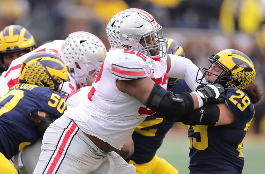 ANN ARBOR, MI - NOVEMBER 30: Wyatt Davis #52 of the Ohio State Buckeyes battles with Jordan Glasgow #29 of the Michigan Wolverines during the first quarter of the game at Michigan Stadium on November 30, 2019 in Ann Arbor, Michigan. Ohio State defeated Michigan 56-27. (Photo by Leon Halip/Getty Images)