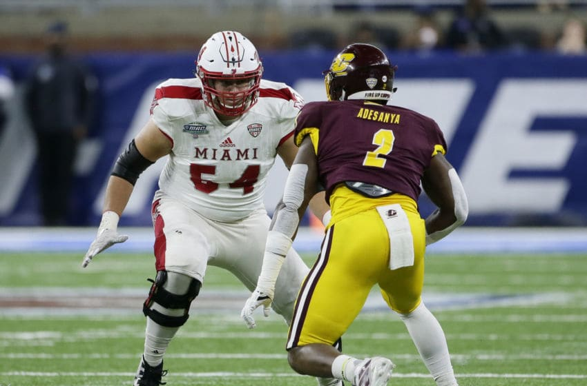 DETROIT, MI - DECEMBER 7: Offensive lineman Tommy Doyle #54 of the Miami (Oh) Redhawks blocks against defensive lineman Sean Adesanya #2 of the Central Michigan Chippewas during the first half of the MAC Championship at Ford Field on December 7, 2019, in Detroit, Michigan. (Photo by Duane Burleson/Getty Images)