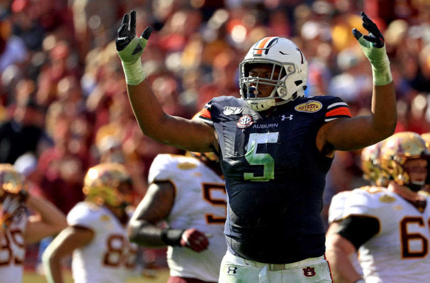 TAMPA, FLORIDA - JANUARY 01: Derrick Brown #5 of the Auburn Tigers reacts to a play during the 2020 Outback Bowl against the Minnesota Golden Gophers at Raymond James Stadium on January 01, 2020 in Tampa, Florida. (Photo by Mike Ehrmann/Getty Images)