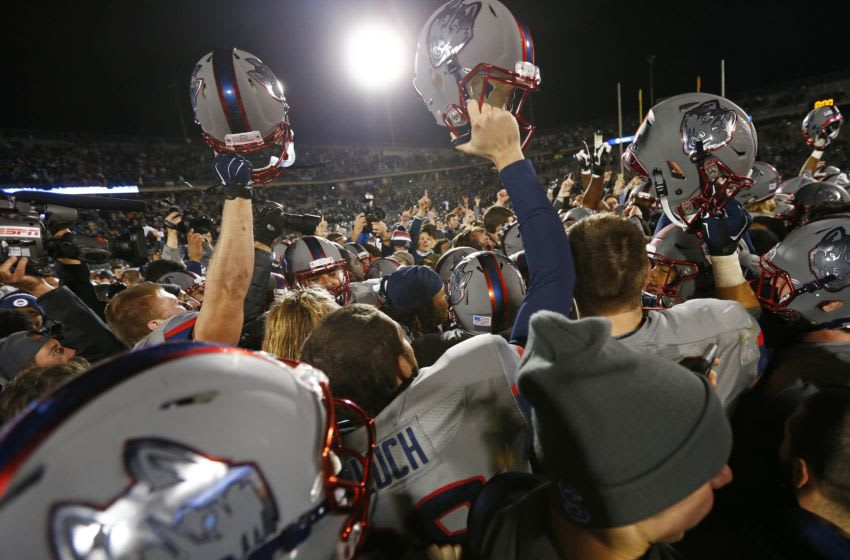 EAST HARTFORD, CT - NOVEMBER 21: Players and fans of the Connecticut Huskies celebrate their 20-17 win over the 13th ranked Houston Cougars at Rentschler Field on November 21, 2015 in East Hartford, Connecticut. (Photo by Rich Schultz /Getty Images)