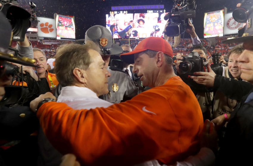 TAMPA, FL - JANUARY 09: Head coach Nick Saban of the Alabama Crimson Tide talks with head coach Dabo Swinney of the Clemson Tigers after the Tigers defeated the Crimson Tide 35-31 in the 2017 College Football Playoff National Championship Game at Raymond James Stadium on January 9, 2017 in Tampa, Florida. (Photo by Streeter Lecka/Getty Images)