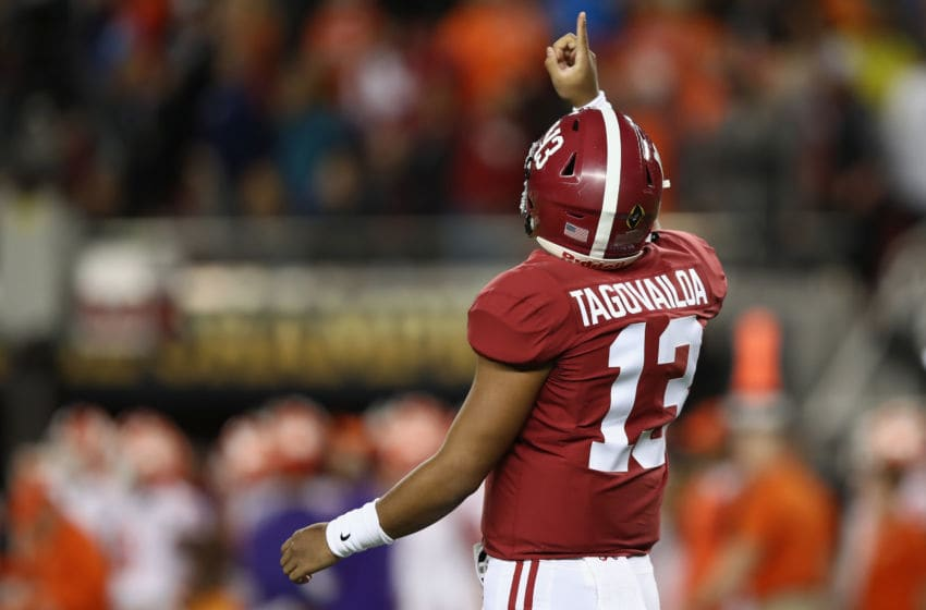 SANTA CLARA, CA - JANUARY 07: Tua Tagovailoa #13 of the Alabama Crimson Tide celebrates his first quarter touchdown throw against the Clemson Tigers in the CFP National Championship presented by AT&T at Levi's Stadium on January 7, 2019 in Santa Clara, California. (Photo by Ezra Shaw/Getty Images)