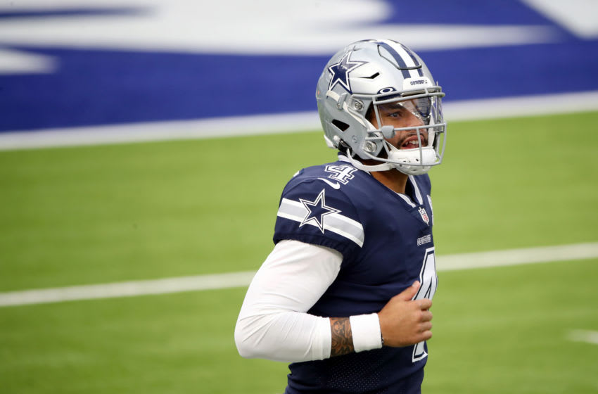 INGLEWOOD, CALIFORNIA - SEPTEMBER 13: Dak Prescott #4 of the Dallas Cowboys runs onto the field before the game against the Los Angeles Rams at SoFi Stadium on September 13, 2020 in Inglewood, California. (Photo by Katelyn Mulcahy/Getty Images)