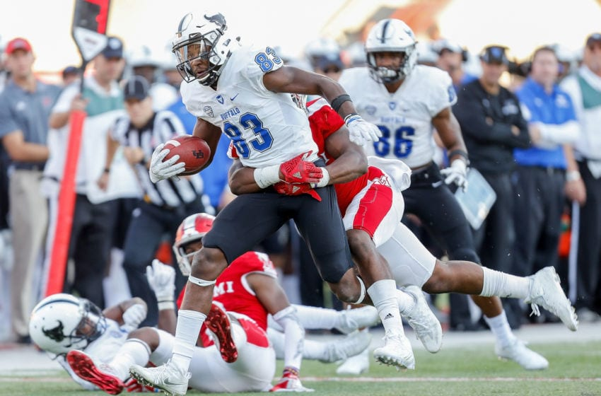 OXFORD, OH - OCTOBER 21: Anthony Johnson #83 of the Buffalo Bulls is tackled by Junior McMullen #5 of the Miami Ohio Redhawks during the second half at Yager Stadium on October 21, 2017 in Oxford, Ohio. (Photo by Michael Reaves/Getty Images)