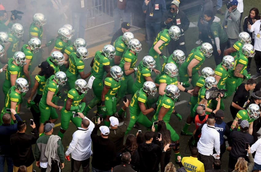 LAS VEGAS, NV - DECEMBER 16: The Oregon Ducks run onto the field as they are introduced before taking on the Boise State Broncos in the Las Vegas Bowl at Sam Boyd Stadium on December 16, 2017 in Las Vegas, Nevada. Boise State won 38-28. (Photo by Ethan Miller/Getty Images)