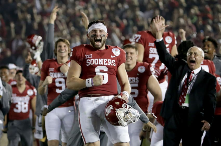 PASADENA, CA - JANUARY 01: Baker Mayfield #6 of the Oklahoma Sooners celebrates after Steven Parker #10 of the Oklahoma Sooners scores a 46 yard touchdown because of a fumble by Sony Michel #1 of the Georgia Bulldogs in the 2018 College Football Playoff Semifinal at the Rose Bowl Game presented by Northwestern Mutual at the Rose Bowl on January 1, 2018 in Pasadena, California. (Photo by Jeff Gross/Getty Images)