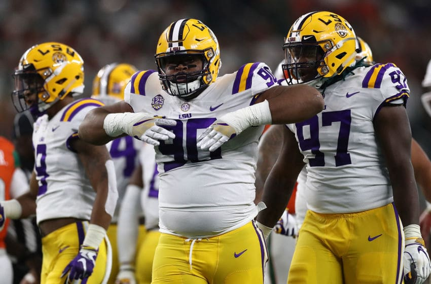 ARLINGTON, TX - SEPTEMBER 02: Rashard Lawrence #90 of the LSU Tigers celebrates a quarterback sack against the Miami Hurricanes in the first quarter during the AdvoCare Classic at AT&T Stadium on September 2, 2018 in Arlington, Texas. (Photo by Ronald Martinez/Getty Images)