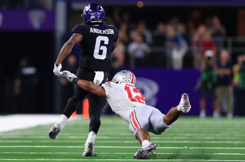 ARLINGTON, TX - SEPTEMBER 15: Darius Anderson #6 of the TCU Horned Frogs breaks a tackle against Sevyn Banks #12 of the Ohio State Buckeyes to score a touchdown in the second quarter during The AdvoCare Showdown at AT&T Stadium on September 15, 2018 in Arlington, Texas. (Photo by Tom Pennington/Getty Images)