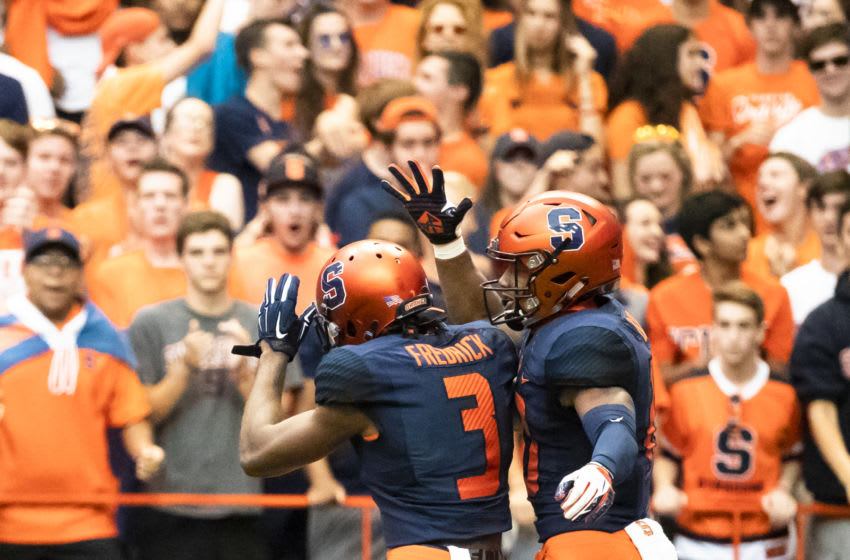 SYRACUSE, NY - SEPTEMBER 08: Andre Cisco #19 and Christopher Fredrick #3 of the Syracuse Orange celebrate Cisco's second interception during the first quarter against the Wagner Seahawks at the Carrier Dome on September 8, 2018 in Syracuse, New York. Syracuse defeats Wagner 62-10. (Photo by Brett Carlsen/Getty Images)