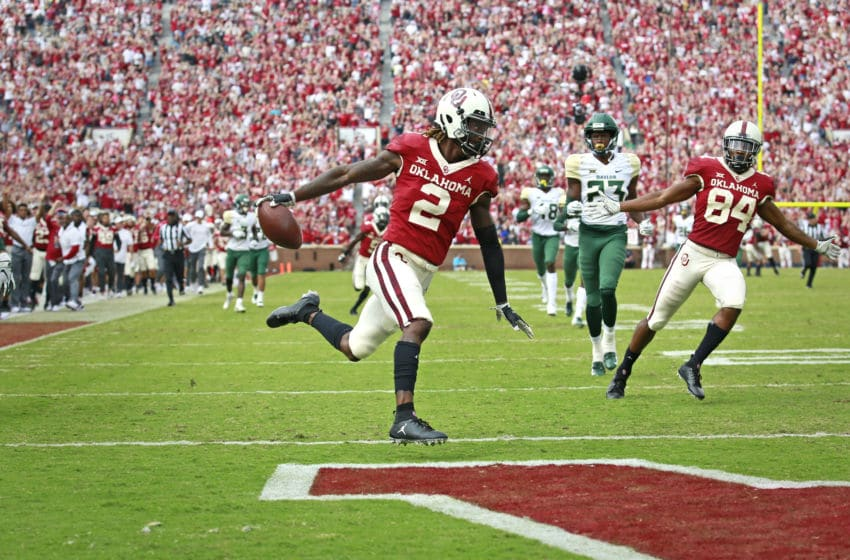 NORMAN, OK - SEPTEMBER 29: Wide receiver CeeDee Lamb #2 of the Oklahoma Sooners scores against the Baylor Bears at Gaylord Family Oklahoma Memorial Stadium on September 29, 2018 in Norman, Oklahoma. Oklahoma defeated Baylor 66-33. (Photo by Brett Deering/Getty Images)