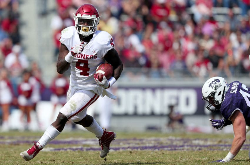 FORT WORTH, TX - OCTOBER 20: Trey Sermon #4 of the Oklahoma Sooners carries the ball into the end zone to score a touchdown the TCU Horned Frogs in the second half at Amon G. Carter Stadium on October 20, 2018 in Fort Worth, Texas. (Photo by Tom Pennington/Getty Images)