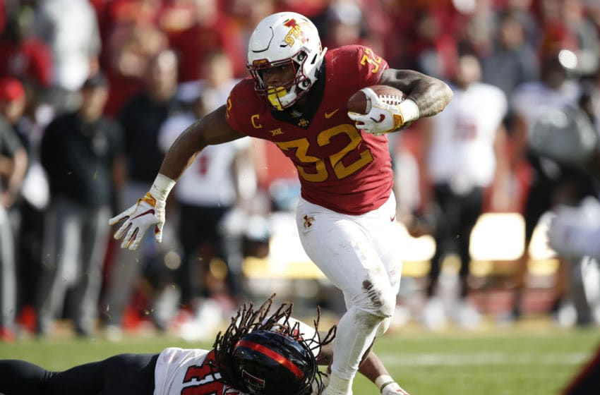 AMES, IA - OCTOBER 27: Running back David Montgomery #32 of the Iowa State Cyclones breaks away from linebacker Dakota Allen #40 of the Texas Tech Red Raiders while rising for yards in the second half of play at Jack Trice Stadium on October 27, 2018 in Ames, Iowa. The Iowa State Cyclones won 40-31 over the Texas Tech Red Raiders. (Photo by David Purdy/Getty Images)