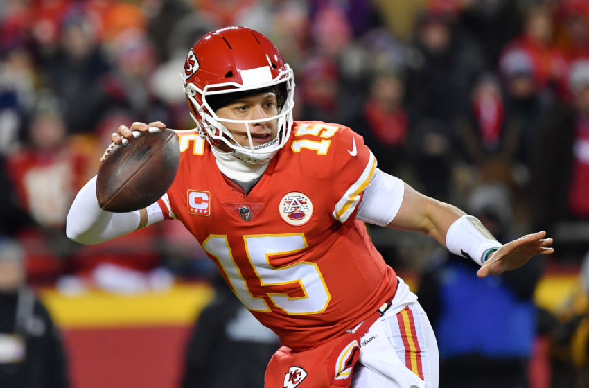 KANSAS CITY, MISSOURI - JANUARY 20: Patrick Mahomes #15 of the Kansas City Chiefs scrambles in the first half against the New England Patriots during the AFC Championship Game at Arrowhead Stadium on January 20, 2019 in Kansas City, Missouri. (Photo by Peter Aiken/Getty Images)