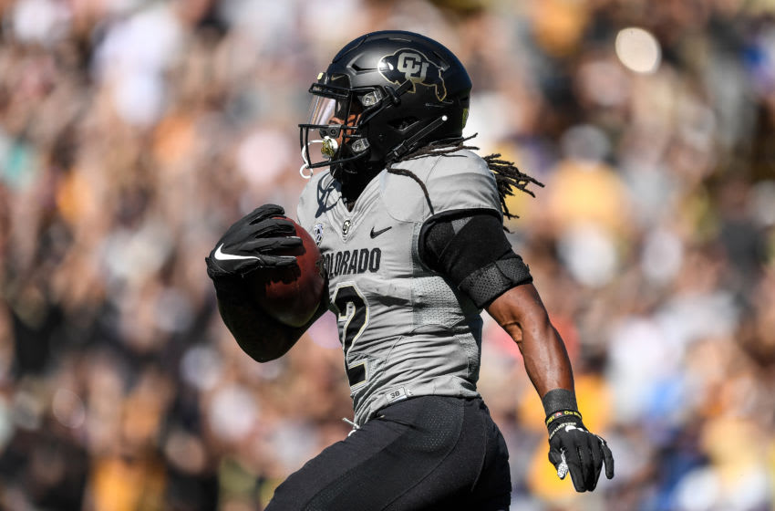 BOULDER, CO - SEPTEMBER 14: Wide receiver Laviska Shenault Jr. #2 of the Colorado Buffaloes carries the ball for a first quarter touchdown after a catch against the Air Force Falcons chases him during a game at Folsom Field on September 14, 2019 in Boulder, Colorado. (Photo by Dustin Bradford/Getty Images)