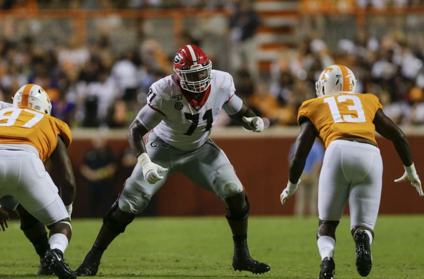 KNOXVILLE, TENNESSEE - OCTOBER 05: Andrew Thomas #71 of the Georgia Bulldogs looks to block DeAndre Johnson #13 of the Tennessee Volunteers during the fourth quarter of the game against the Tennessee Volunteers at Neyland Stadium on October 05, 2019 in Knoxville, Tennessee. (Photo by Silas Walker/Getty Images)