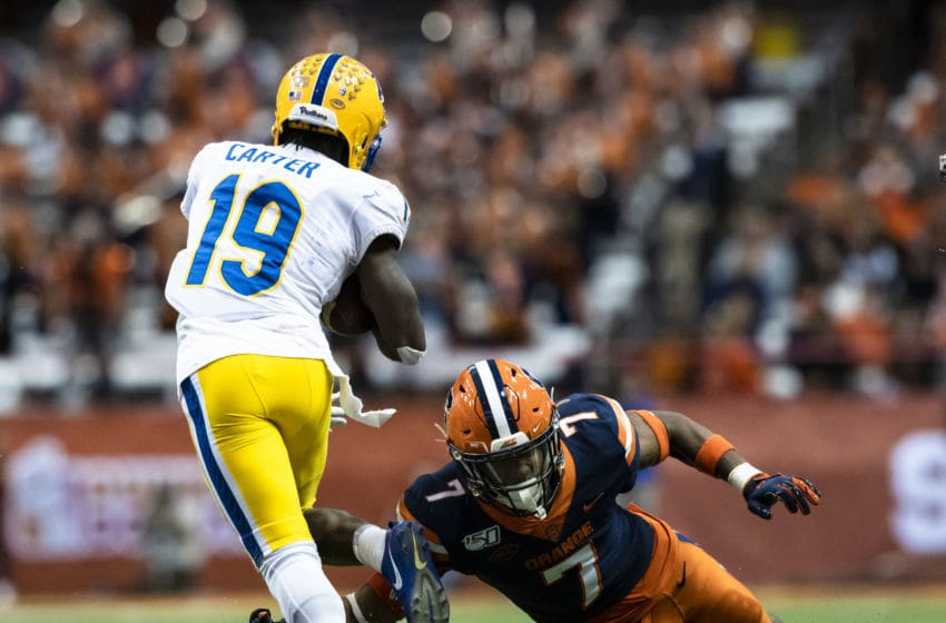SYRACUSE, NY - OCTOBER 18: V'Lique Carter #19 of the Pittsburgh Panthers hurdles a tackle attempt by Andre Cisco #7 of the Syracuse Orange during the third quarter at the Carrier Dome on October 18, 2019 in Syracuse, New York. Pittsburgh defeats Syracuse 27-20. (Photo by Brett Carlsen/Getty Images)