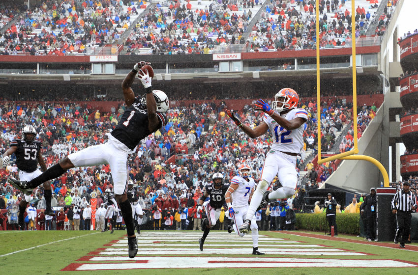 COLUMBIA, SOUTH CAROLINA - OCTOBER 19: Jaycee Horn #1 of the South Carolina Gamecocks goes after a pass against C.J. McWilliams #12 of the Florida Gators during their game at Williams-Brice Stadium on October 19, 2019 in Columbia, South Carolina. (Photo by Streeter Lecka/Getty Images)