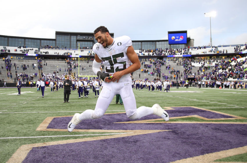SEATTLE, WASHINGTON - OCTOBER 19: Troy Dye #35 of the Oregon Ducks celebrates after defeating the Washington Huskies 35-31 during their game at Husky Stadium on October 19, 2019 in Seattle, Washington. (Photo by Abbie Parr/Getty Images)