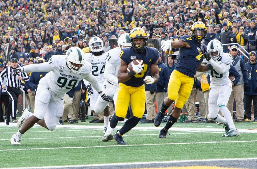 ANN ARBOR, MI - NOVEMBER 16: Donovan Peoples-Jones #9 of the Michigan Wolverines runs for a first down late in the fourth quarter of the game against the Michigan State Spartans at Michigan Stadium on November 16, 2019 in Ann Arbor, Michigan. Michigan defeated Michigan State 44-10. (Photo by Leon Halip/Getty Images)